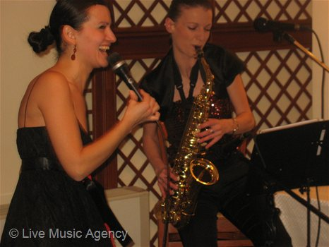 Jazz trio saxophone guitar vocal | фото: livemusicagency.com