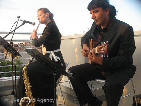 Saxophone and guitar duo Official Cocktail | photo: livemusicagency.com